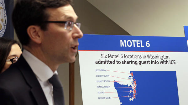 Washington state Attorney General Bob Ferguson addresses a news conference Wednesday in Seattle, announcing that his office is suing Motel 6.