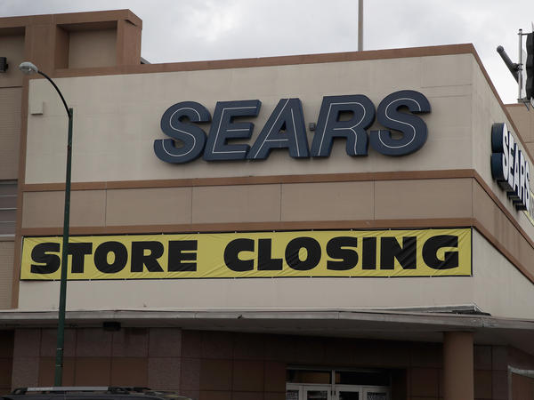 A sign announcing the store will be closing hangs above a Sears store on Aug. 24 in Chicago. Sears Holdings, which owns Sears and Kmart, said Thursday it was planning to close another 103 stores.