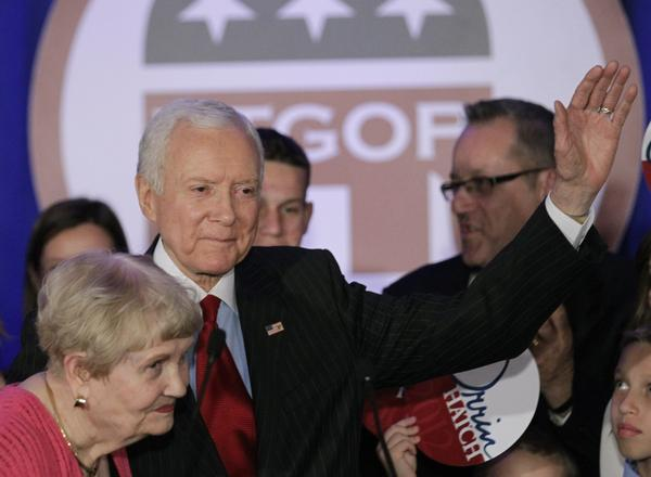 Sen. Orrin Hatch, R-Utah, waves to the crowd after his re-election victory speech in 2012. He is retiring, opening a path for Mitt Romney to possibly run for the seat.