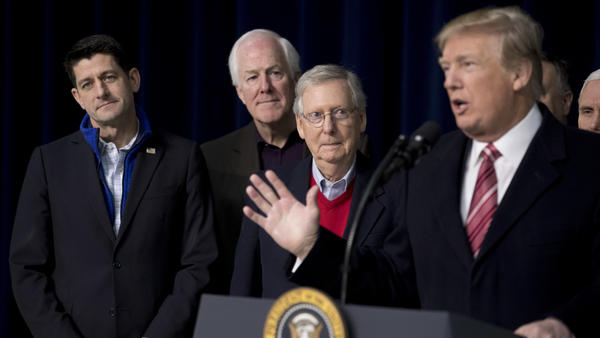President Trump, with House Speaker Paul Ryan of Wisconsin, Senate Majority Whip John Cornyn, R-Texas., and Senate Majority Leader Mitch McConnell of Kentucky, speaks to reporters after a retreat where GOP leaders made plans for 2018.