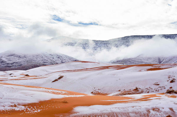 A scene of snow, striped in orange: This is how the desert surrounding Ain Sefra in Algeria appeared to residents for a few fleeting hours Sunday.