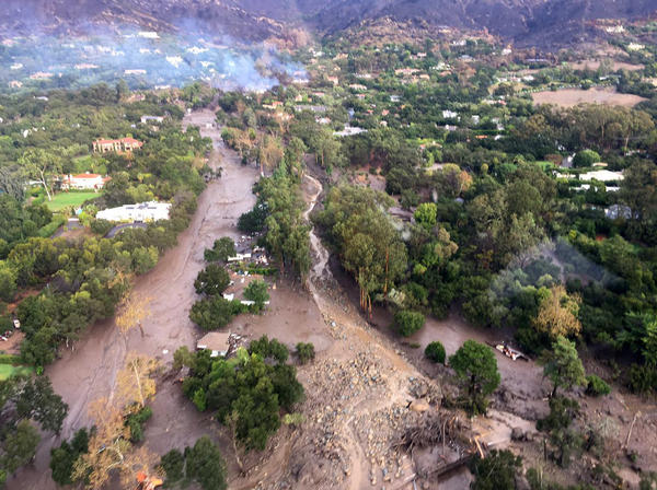 Several homes were swept away before dawn Tuesday when mud and debris roared into neighborhoods in Montecito from hillsides stripped of vegetation during a recent wildfire.