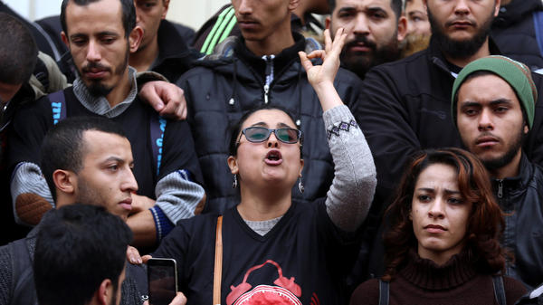A demonstrating graduate shouts slogans during protests against rising prices and tax increases, in Tunis on Tuesday.