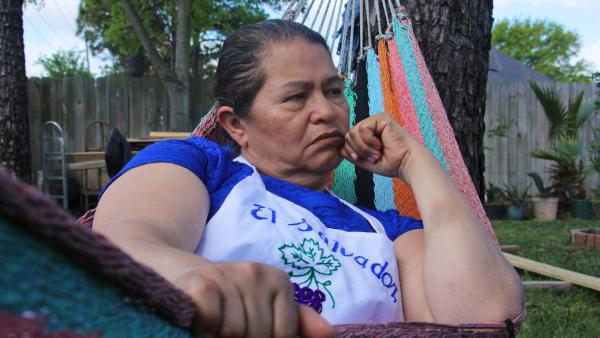 This portrait of a woman from El Salvador reflects the wariness and uncertainty discussed in <em>Alt.Latino</em> this week.