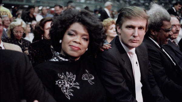 "Donald Trump and Oprah Winfrey are seated ringside for a June 1988 boxing match in Atlantic City, N.J. When asked this week about a potential challenge from Winfrey in 2020, Trump responded, ""Yeah, I'll beat Oprah."""