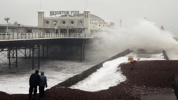 Waves crash onto the beach near Brighton Pier in England, in January 2007. Gale force winds and heavy rain brought disruption to large parts of the country. Severe weather events like this one may be linked to more frequent fluctuations in the polar jet stream, according to a new study.