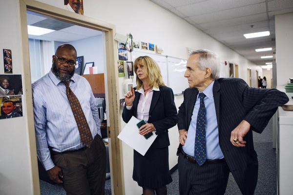 Capt. Steve Roberts (left) talks through a case with Assistant Prosecutor Kathleen Lyons-Boswick and Laurino inside the Special Victims Unit of Wynona's House.