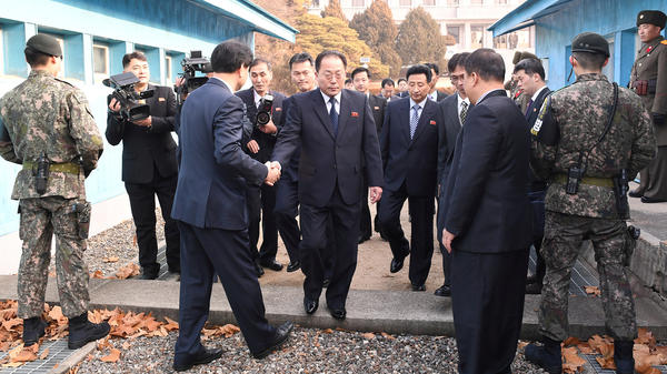 With North Korea planning to participate in the 2018 Winter Olympics, delegation head Jon Jong Su, vice chairman of the Committee for the Peaceful Reunification of the Country, crosses the concrete border to attend a meeting at the truce village of Panmunjom in the demilitarized zone separating the two Koreas.