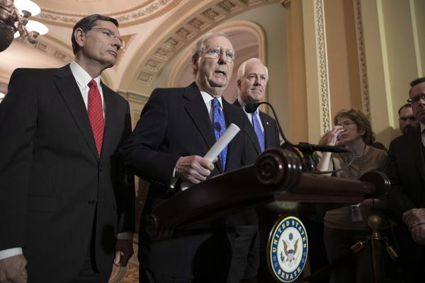 Senate Majority Leader Mitch McConnell, R-Ky., flanked by Sen. John Barrasso, R-Wyo., left, and Majority Whip John Cornyn, R-Texas, speaks to reporters about efforts to avoid a government shutdown this weekend, at the Capitol in Washington, Wednesday, Jan. 17, 2018. (J. Scott Applewhite/AP)