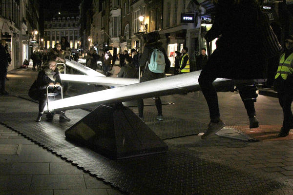 The <em>Impulse</em> installation allows people to sit on seesaws that light up.<em> </em>