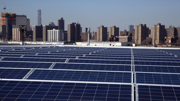 A rooftop is covered with solar panels at the Brooklyn Navy Yard in New York last February. The Trump administration is considering whether to impose tariffs on imports of solar materials.