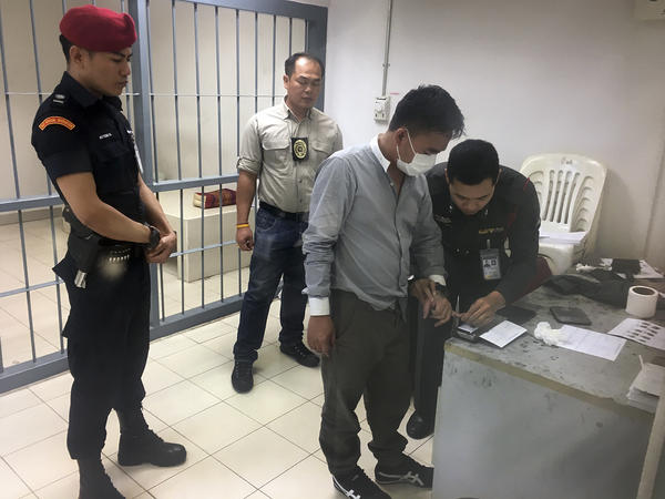Thai police process suspected wildlife trafficker Boonchai Bach, who was arrested after an X-ray inspection last month of a bag on a flight from Ethiopia revealed the rhino horns.