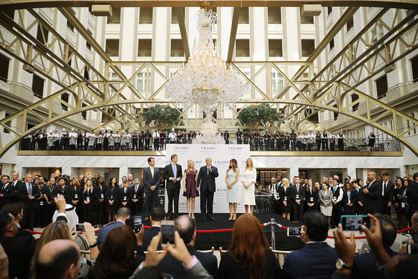 Then-presidential candidate Donald Trump (C) and his family prepare to cut the ribbon at the new Trump International Hotel on October 26, 2016, in Washington, D.C.