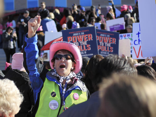 "Diane Askwyth leads cheers as protestors make their way to Sam Boyd Stadium for the Women's March ""Power to the Polls"" voter registration tour launch on January 21, 2018, in Las Vegas, Nevada."