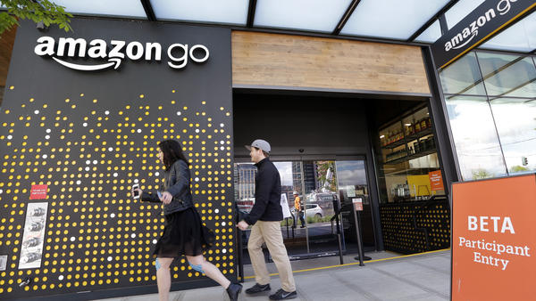 People walk past an Amazon Go store in Seattle in April, when it was open only to Amazon employees.