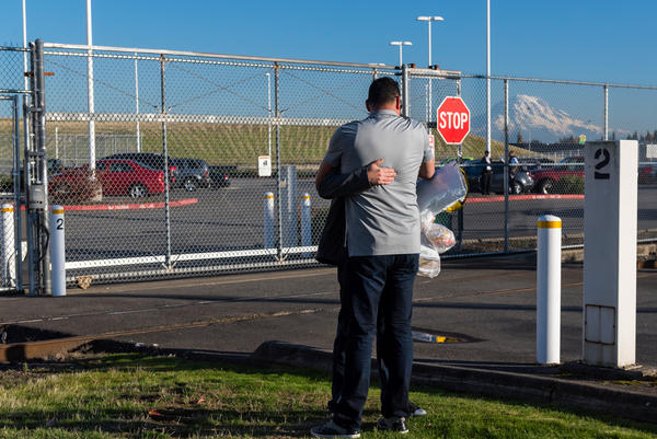 On the day he is released, Manuel is hugged by a friend at the detention center. The fact that he had a lawyer greatly improved his chances of avoiding deportation.