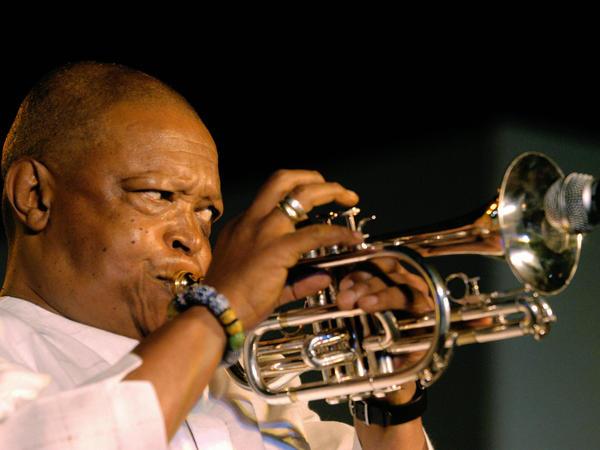 South African musician Hugh Masekela, performs in New Delhi in 2004.