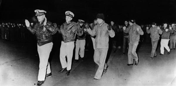 Lt. Cmdr. Lloyd Bucher, commander of the USS Pueblo, leads his surviving crew members as they arrive in North Korea following their capture on Jan. 23, 1968.