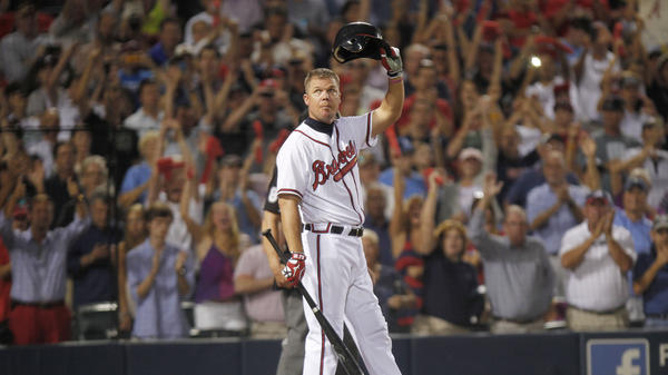 Atlanta Braves third baseman Chipper Jones tips his helmet to the crowd during his last at-bat in October 2012 in Atlanta. Jones played 19 seasons — all with the Braves — hitting 468 home runs. He's the only switch-hitter in major league history to have a .300 batting average for his career.