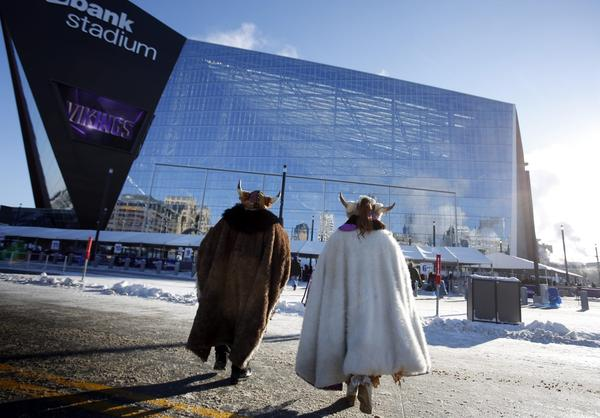 Fans bundled up for the cold weather head for U.S. Bank Stadium before the start of an NFL football game between the Indianapolis Colts and the Minnesota Vikings Sunday, Dec. 18, 2016, in Minneapolis. (Andy Clayton-King/AP)