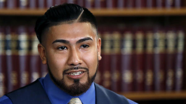 Luis Pedrote-Salinas, seen at a July news conference, is suing the Chicago Police Department for including him in a gang database, an inaccurate designation that he thinks cost him the chance for protection under the DACA program.