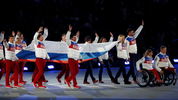 Russia's Paralympic athletes who compete in South Korea will do so under a neutral flag, part of the team's punishment for doping infractions. Here, Russian athletes are seen in the closing ceremony of the 2014 Paralympic Winter Games in Sochi, where the Russian team dominated.