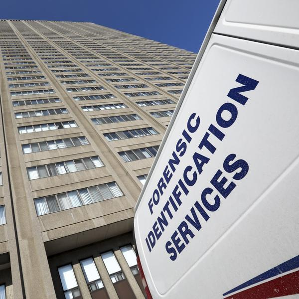 A Police Forensic Identification Services vehicle on scene while authorities comb through an apartment in Toronto in connection with the investigation of an alleged serial killer.