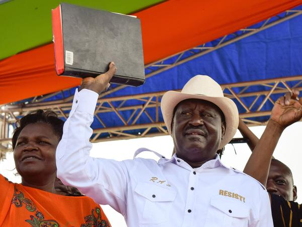 Kenyan opposition party National Super Alliance (NASA) leader, Raila Odinga holds a bible during a rally in Homa Bay on the shores of Lake Victoria, Kenya, on Saturday.