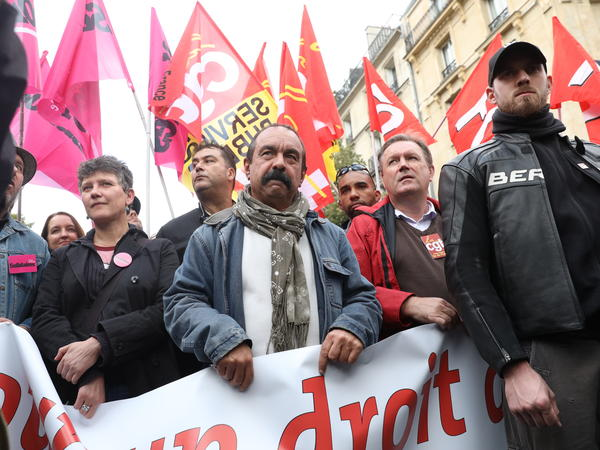 Demonstrators including French trade union leader Philippe Martinez, center, protest against President Emmanuel Macron's fast-tracked labor law reforms on Sept. 12 in Paris.