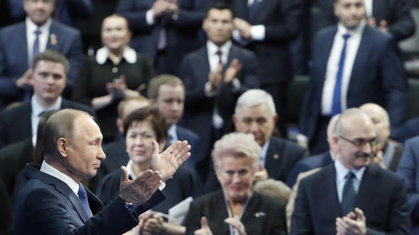 Russian President Vladimir Putin, seen here during a campaign meeting with supporters on Tuesday, compared the U.S. list to a dog barking at a caravan.
