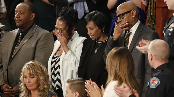 Robert Mickens (from top left), Elizabeth Alvarado, Evelyn Rodriguez, Freddy Cuevas, parents of two Long Island teenagers who were believed to have been killed by MS-13 gang members, during Trump's speech.