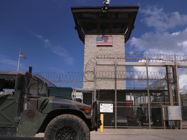 """A humvee passes the guard tower guard tower at the entrance of the U.S. prison at Guantanamo Bay, also known as """"Gitmo"""" in October 2016. October 23, 2016 at the U.S."""