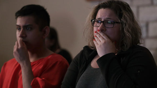 Angelica Magana, 34, a Deferred Action for Childhood Arrivals program recipient who was brought to the United State at the age of 8, and Victor Guzman, an undocumented resident, react to President Trump's remarks about his immigration policy during a State of the Union watch party Tuesday in Chicago.