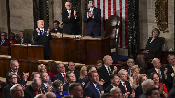 President Trump leads applause for guests in the first lady's box during the State of the Union address to a joint session of Congress on Tuesday.