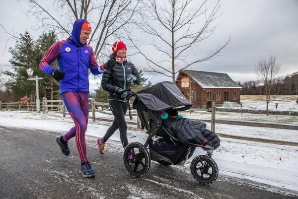 Lowell Bailey runs with his wife Erika and baby daughter Ophelia near their Lake Placid home.