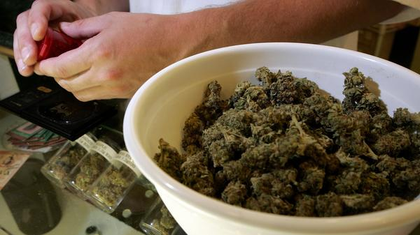 A worker packages medical marijuana in San Francisco in 2006. City prosecutors say they'll clear thousands of marijuana convictions.