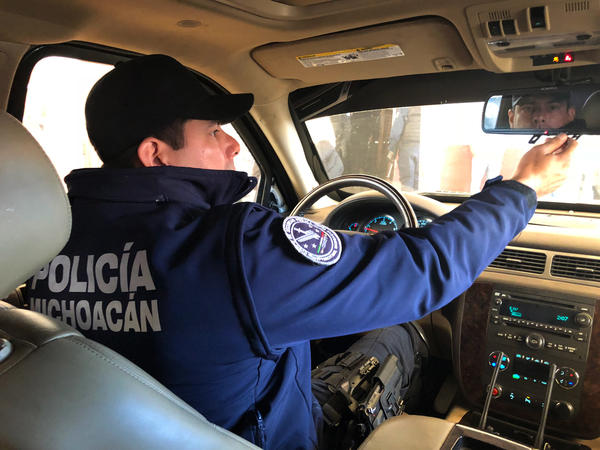 Tancitaro Assistant Police Chief José Antonio Flores Quezada patrols the town in an armored pickup. His family has been in the avocado business for generations and used to have to pay extortion money to organized crime gangs. Four years ago, he joined the fight to run the gangs out of town.