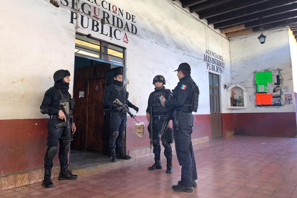 Police officers of Tancitaro's 80-member force gather before going out on patrol.