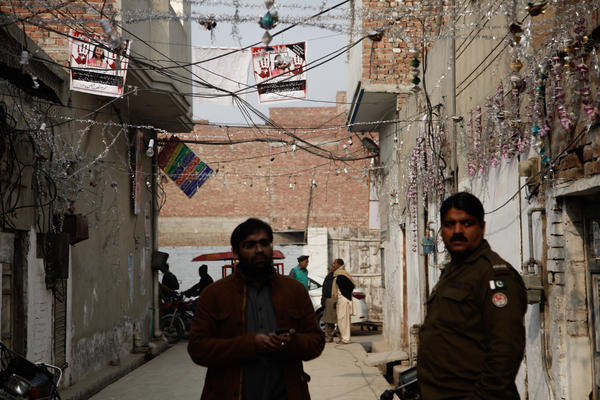 The posters with Zainab's photo and calls for justice are strung outside her home in an alleyway in Kasur.