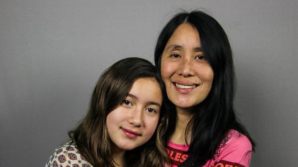 Lan Cao, 53, with her daughter, Harlan, 12, at their StoryCorps interview in Westminster, Calif. in January 2015. During the interview, Lan tells her daughter about her experience during the Tet Offensive in Vietnam in 1968.