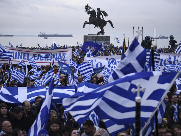 "Greek protesters in Thessaloniki wave flags and banners during a rally against the use of the term ""Macedonia"" for the neighboring country's name on Jan. 21. Greek authorities argue that the name Macedonia might suggest that Skopje has territorial claims to the northern Greek region of the same name with Thessaloniki as its capital."