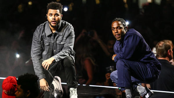 "Kendrick Lamar joins The Weeknd on stage during the ""Legends of The Fall Tour"" in 2017."