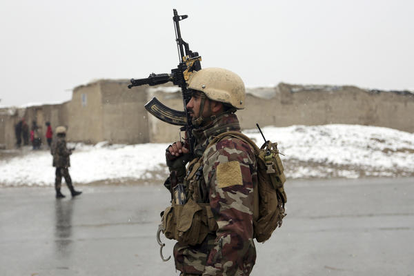 A member of Afghan security personnel stands guard at the site of an attack at the Marshal Fahim academy in Kabul, Afghanistan Monday, Jan. 29, 2018. Insurgents attacked an Afghan army unit guarding the military academy in the capital of Kabul on Monday, officials said. (AP Photo/Rahmat Gul)