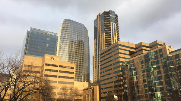 Denver's newest skyscraper (center) followed new building codes for energy efficiency. The city wants to reduce greenhouse gas emissions 80 percent by 2050.