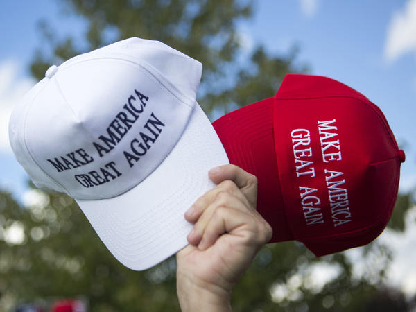 A vendor sells hats to supporters before a campaign rally for then-candidate Donald Trump in Newtown, Pa. While sales of Trump merchandise helped fund his campaign, large donors increasingly dominate the funding of political campaigns.