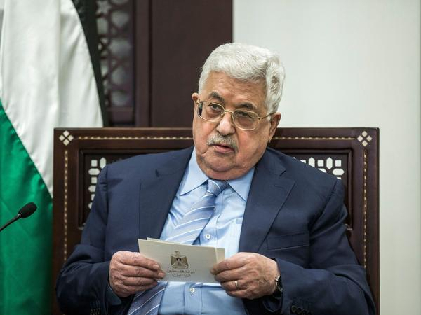 Palestinian President Mahmoud Abbas reads from a placard during his meeting with the German Foreign Minister at the Palestinian presidential complex in the West Bank city of Ramallah on Jan. 31.