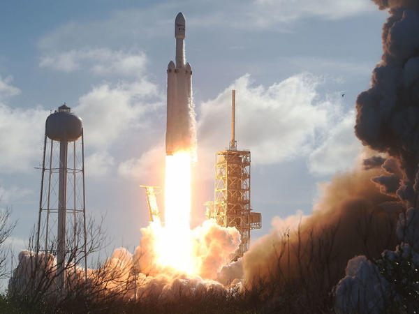 The SpaceX Falcon Heavy rocket lifts off from launch pad 39A at Kennedy Space Center on Tuesday in Cape Canaveral, Fla.