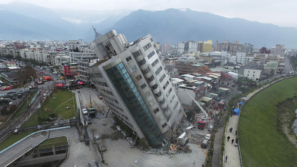 A residential building leans on its collapsed first floor Wednesday, just a day after an earthquake in Hualien, Taiwan.