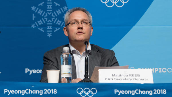 Matthieu Reeb, secretary-general of the Court of Arbitration for Sport, announces the court's decision on Feb. 1 regarding Russian athletes. He is set to announce another decision Friday.