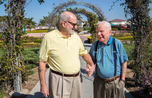 Jerry Nadeau, 72, (left) and his husband, John Banvard, 100, stand outside their home in Chula Vista, Calif.